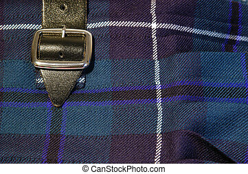 Kilt Buckle - Close up of a buckle on a scottish kilt
