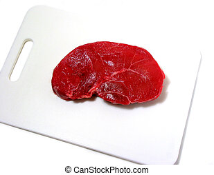 Raw steak on cutting board