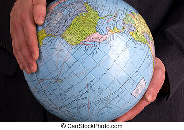 The World - A Business Man Holding A Globe