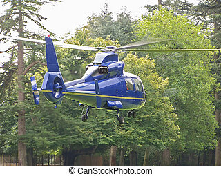 Blue Helicopter - A blue helicopter taking off