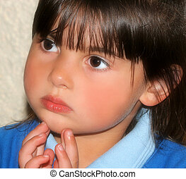 Little Girl Deep In Thought - The face of a little girl deep...