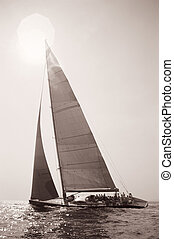 Old Time Sailing - Sepia shot of a yacht sailing into the...