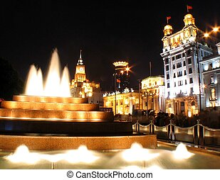 Fountain of Dreams - Fountain outside buildings at night in...