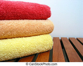 Towel stack 3 - Stack of bright colorful clean towels on a...