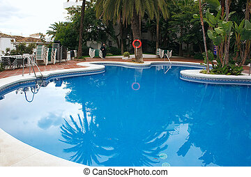 swimming pool - looking across the top of a swimming pool to...