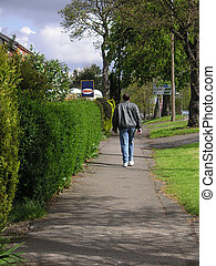 man walking along the sidewalk