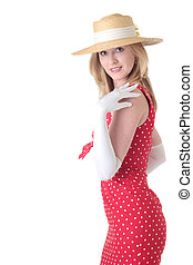 Pretty woman in fifties style dress standing on white