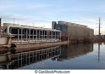 Cooling Towers - Power plant cooling towers refect in a...