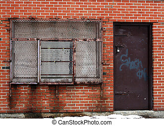 old window with bars - old brick building with window with...