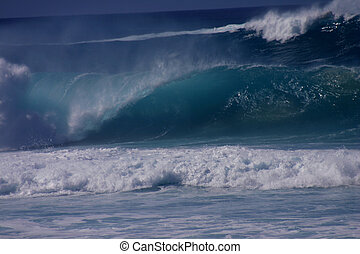 Huge Wave III - A large wave crashes at Pipeline.