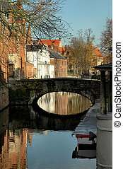 Bridge Along Canal - Bridge and colorful buildings along...