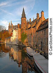 Canal Buildings - Buildings along canal with boats in the...