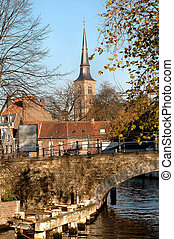 Bridge Over Canal - Bridge over canal with church in...