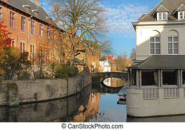 Canal in Brugges - Canal, buildings and bridge in Brugges,...