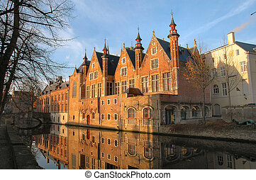 Brick Buildings - Brick buildings with reflection in canal...