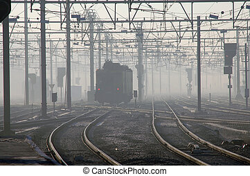 Train In Fog - Train with red signal lights in early morning...