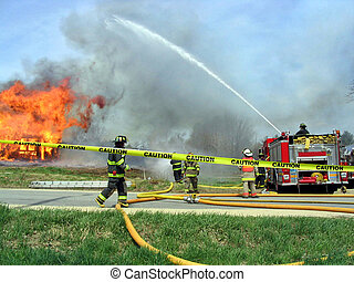 Caution - , firefighters at the scene of a fire