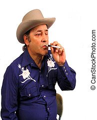 Not the Marlbro Man - , a cowboy smoking a cigarete in a...