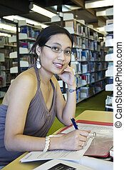 Beautiful Student - Asian student studying in the library