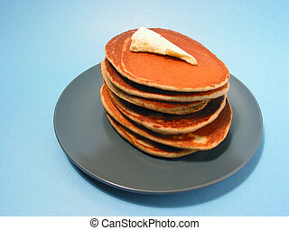Pancakes stack on a plate - Stack o freshly made pancakes on...