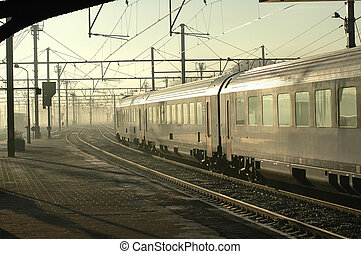 Train In Fog - Silver train leaving Brugges, Belgium station...