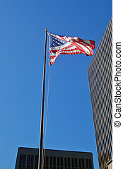 Corporate America - Flag in front of some corporate office...