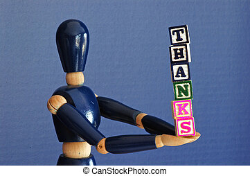 Gift of Thanks - A wooden figure offers up a metaphorical...