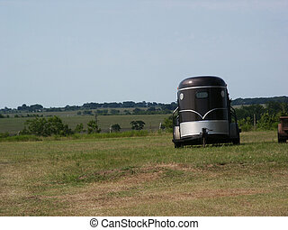 Country View - A horse trailer parked in a pasture out in...