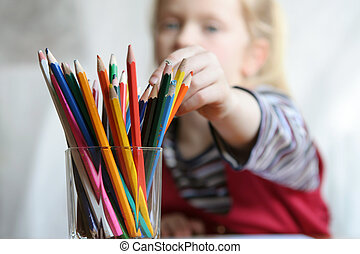 Choosing crayon - Crayons against a background of a little...