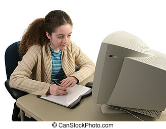 Graphic Tablet Concentration - A teen girl concentrating as...