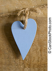 Hanging On A String - A blue wooden heart hanging on a...