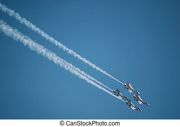 Air Force Thunderbirds - Thunderbird F-16s performing at an...