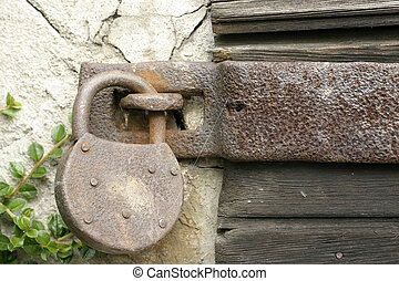 security - a rusty old lock