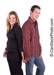 Holding Hands(Isolated) - A Young Attractive Happy Couple...