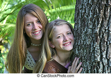Teen Sisters By Tree