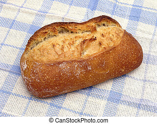 Fancy Bread - Loaf of golden brown fancy bread on a blue...
