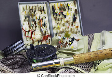 Flyfishing supplies II - Open fly box, rod and reel, vest...