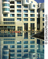 hotel pull - Building of hotel reflected in water of the...