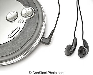 discman - an mp3/cd player with ear-buds plugged in