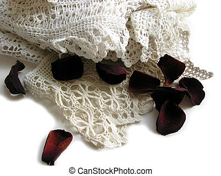Vintage lace and rose petals