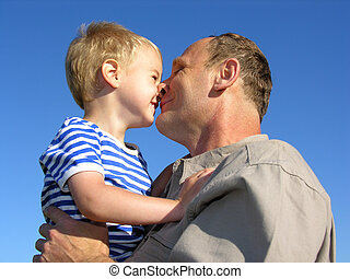 grandfather with grandson kiss by nose