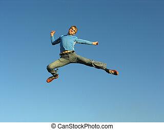 man fly on blue sky