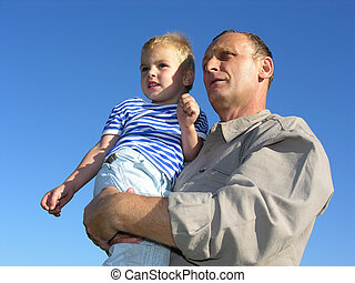 grandfather with grandson look at horizon and future