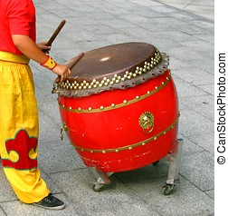 Chinese Drummer at Work - -- this type of drum is called...