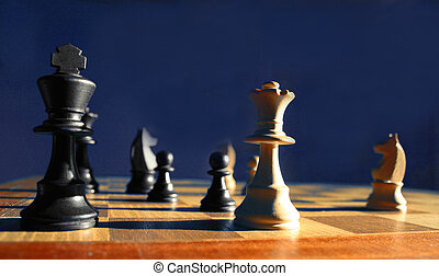 Checkmate - Dramatic image of a side lit chess game