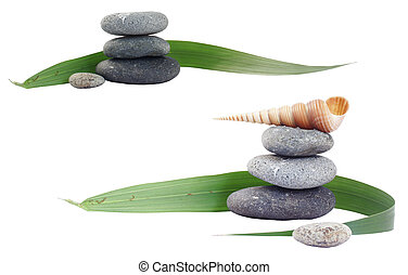 Zen Still Life - Pebble stacks with palm leaf and seashel;...