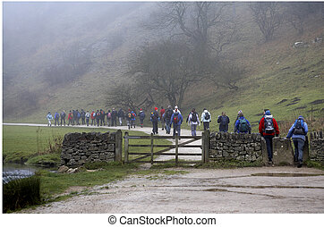 Walkers setting off on a foggy morning, Dovedale, Peak...