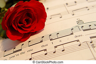 Love song - Red rose on romantic sheet music