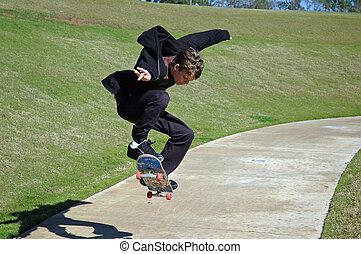 Teen Skater Shadow - A teen boy skateboards while his shadow...