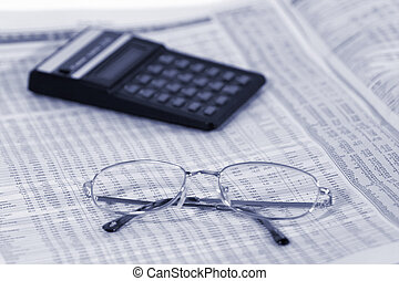 Finance - Glasses and calculator on financial newspaper